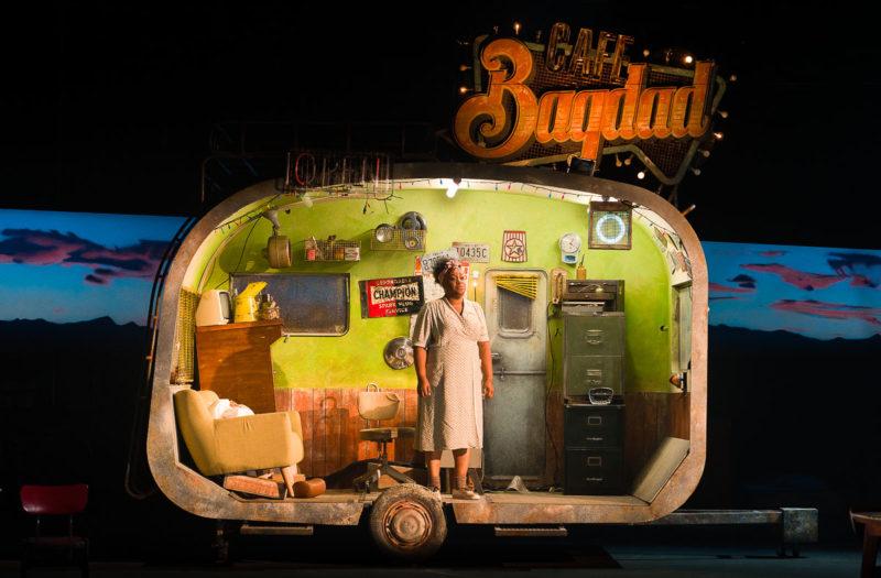 Woman stands in caravan