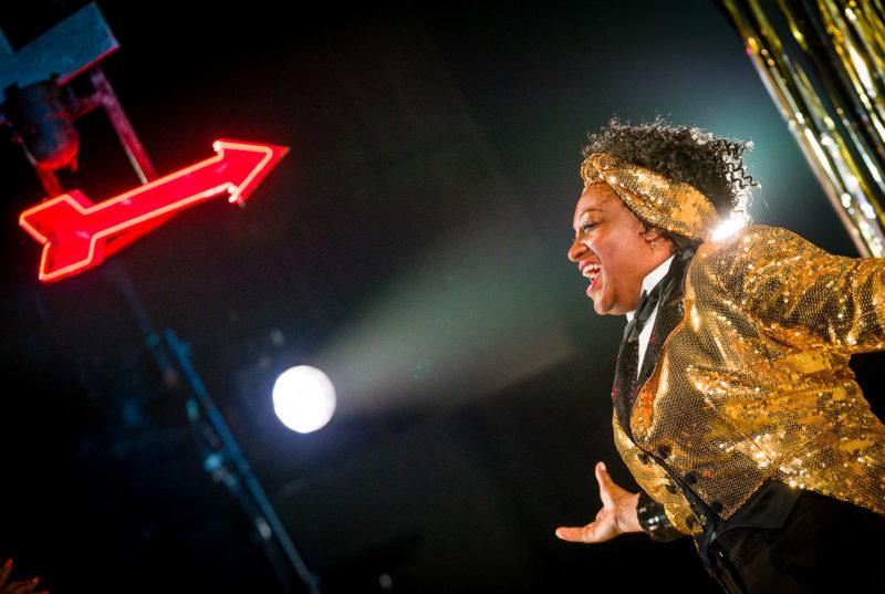 Woman sings into the spotlight