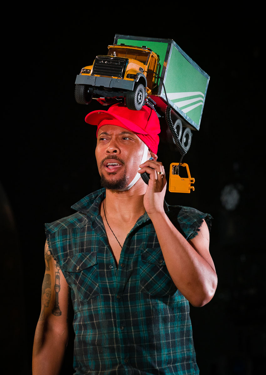 Man wearing a truck on his hat