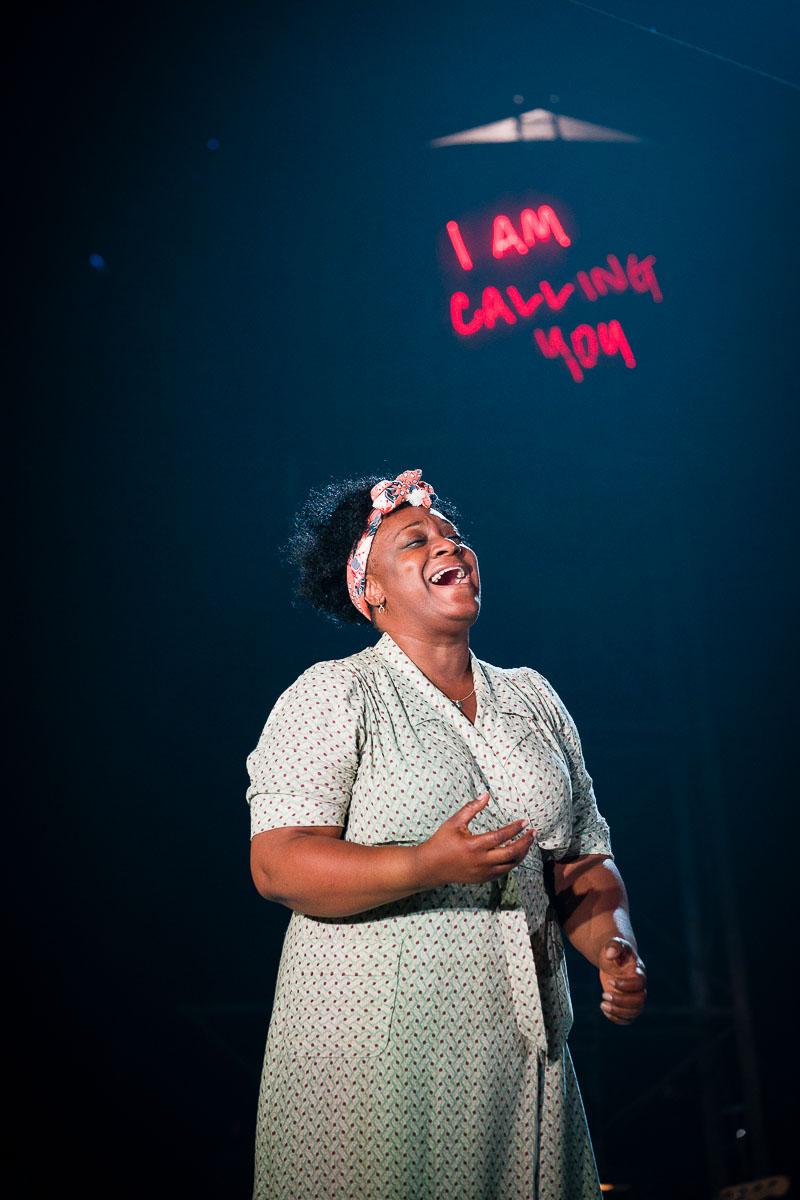Woman singing 'I am Calling You'